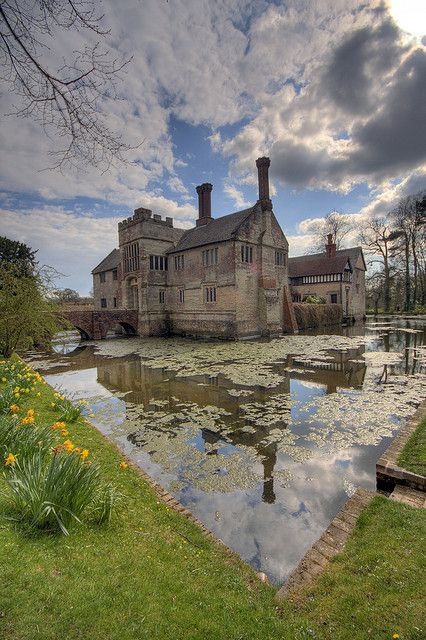 Baddesley Clinton, Warwickshire. With me mother. The sky didn't quite look like that the day I went. I got to dress up though. And hang out with some scarecrows.