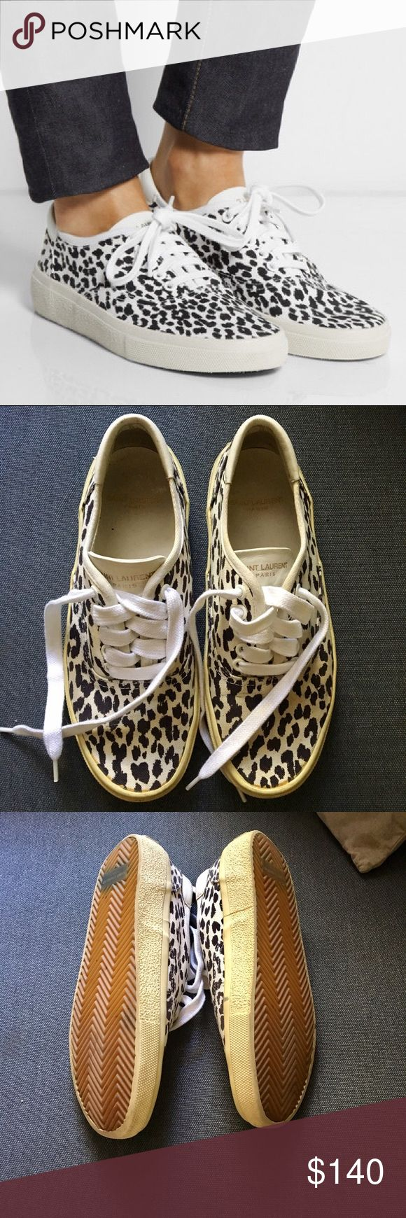 """Saint Laurent Leopard Print Canvas Sneakers Saint Laurent Leopard Print Canvas Sneakers. Sole approx 1"""". Crafted from canvas with a leather tongue and a gold Saint Laurent stamp. Minimal wear on soles, but shoes themselves have lots of wear. Yellow glue marks along soles, minors scuffs here and there, one scrape on the leather trim. All pictured. Still adorable and priced accordingly! First pic is stock.   On here to declutter, 🚫 trades. If I want something in your closet badly enough, I'll…"""