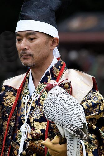 Japanese falconer.  Photography by Bogdan Ionescu on Flickr