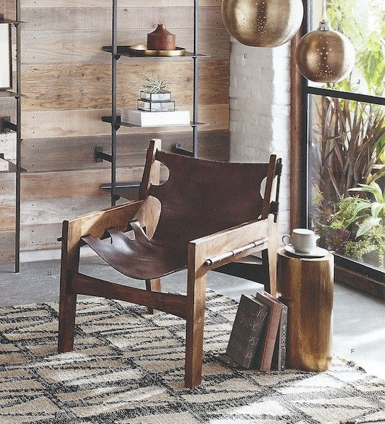 Roost Paolo Chair. A wonderful comfortable chair crafted out of sheeham wood and chocolate brown leather. The leather wraps your contours giving unmatched comfort.