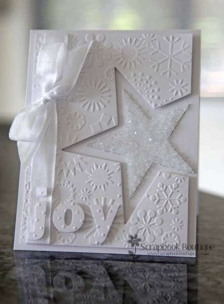 Christmas# card# :White on White...luv the sparkly glittered star in the negative space of a die...placed off the edge in just the right spot...embossing folder snowflakes...die cut joy...tied up with a bow... Stampin up#. Carte# de Noël#. Fond embossé, étoile coupée avec un die. Lettres découpées à la big shot. Un ruban. Le tout en blanc.