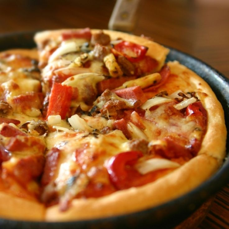 A delicious thick crusted pizza that is chewy and crunchy in the perfect combination. Try our meaty topping suggestion, or create your own.. Chicago Style Deep Dish Pizza Recipe from Grandmothers Kitchen.