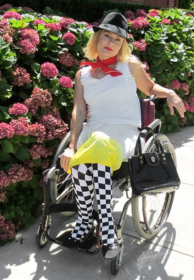 #rudegirl #streetstyler #ska checkered black and white tights, fedora and patent leather black purse. #wheelchair #disabled #fashion.