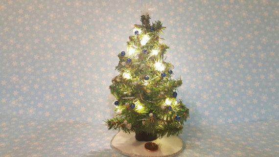 Check out this item in my Etsy shop https://www.etsy.com/listing/495693441/dollhouse-miniature-christmas-tree-blue