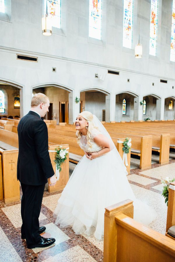 An excited bride and groom during their first look moment captured by their wedding photographer right before at their church wedding ceremony venue.