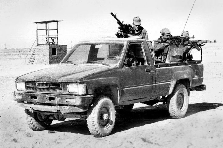 Soviet Spetsnaz GRU operatives riding an armed Toyota pickup, captured from the mujahideen, during the Soviet-Afghan war, 1980s. Captured trucks would be often used by Soviet special forces, disguised as locals, to attack mujahideen convoys.