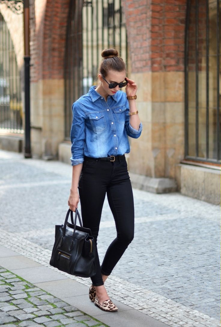 Shop this look on Lookastic:  http://lookastic.com/women/looks/sunglasses-watch-bracelet-denim-shirt-belt-skinny-jeans-tote-bag-loafers/10745  — Black Sunglasses  — Gold Watch  — Gold Bracelet  — Blue Denim Shirt  — Black Leather Belt  — Black Skinny Jeans  — Black Leather Tote Bag  — Beige Leopard Suede Loafers