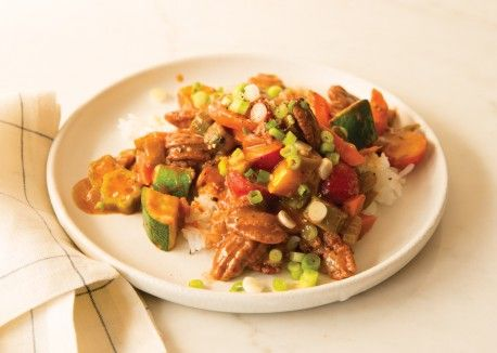 """Rather than use meat substitutes, we turned to pecans to give this gumbo its """"meaty"""" heft and a hit of protein. As they cook, the pecans become tender and chewy while lending the sauce a hint of nutty flavor. Feel free to spice things up with extra Cajun seasoning and hot sauce."""