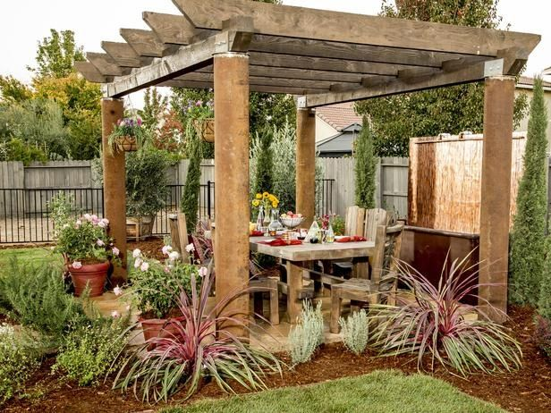 Rustic Patio with Pathway, Weathered Wood Rustic Timber Trestle Dining Table, Fence, 12 ft. x 12 ft. Vineyard Wood Pergola