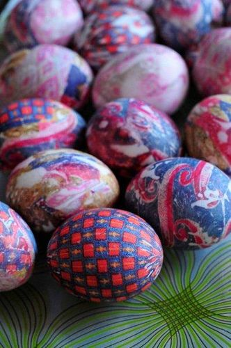 Silk-necktie-dyed eggs!  Tightly wrap & tie the silk from a necktie around an egg, Wrap again with a white cotton cloth, boil eggs for 20 min. in water with 1/4 c. of white vinegar, remove to cool let dry, remove tie and the pattern from the tie gets imprinted on the eggs! Silk fabric or scarf will work too. If using blown eggs set colander on top to hold eggs down.