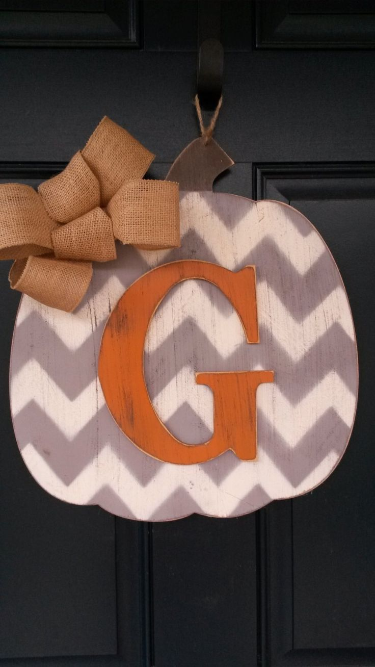 Fall door decor, Wood pumpkin door decor with intital, Fall door decor with monogram, Front door decor by BlessHerHeartDesigns on Etsy https://www.etsy.com/listing/205719160/fall-door-decor-wood-pumpkin-door-decor