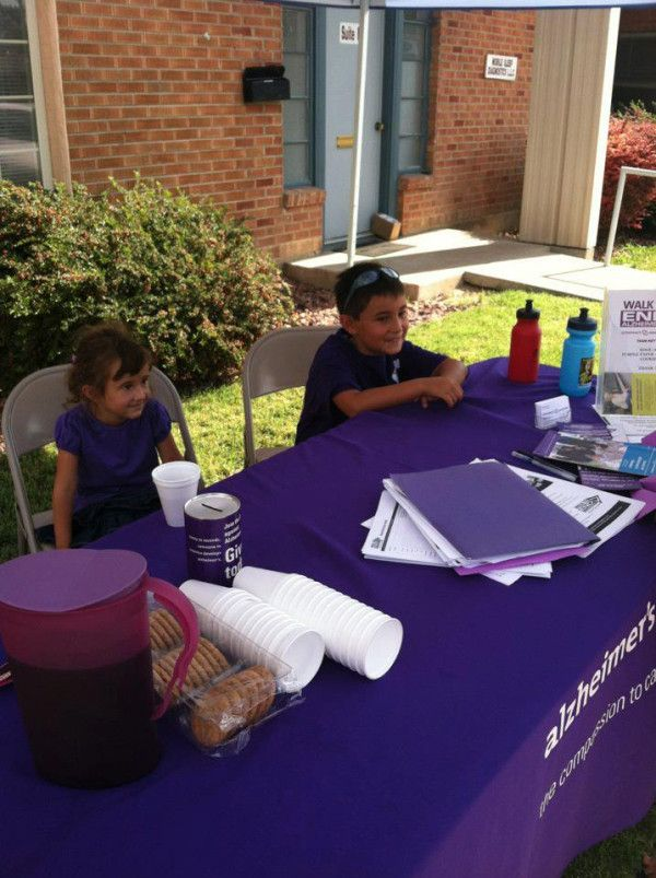A purple Kool Aid stand and sold purple paper airplanes to passers by outside of our Grand Junction offices. The stand made $25 over the weekend, and a gentleman stopped in yesterday to donate a $100 bill to them! The proceeds of the sales went to support their family's Team for the upcoming Walk to End Alzheimer's. Pretty impressive for a 1st grader and pre-schooler!  http://www.facebook.com/alzco  http://www.ColoradoAlzWalk.org