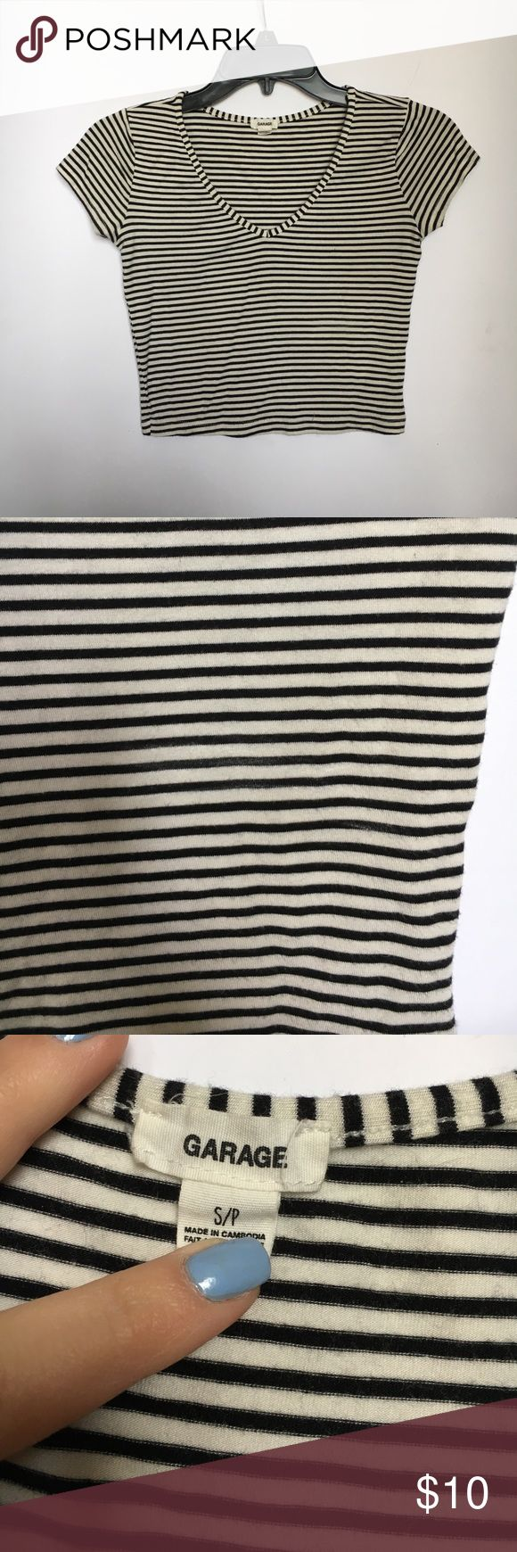 Garage Black and White Striped Vneck Crop Top Worn and washed a few times. Garage black and white striped vneck crop top. Fits extremely well and very flattering when paired with high waisted jeans or shorts! Perfect for spring and summer. Garage Tops Crop Tops
