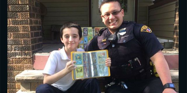 Police Officer Gives His Pokemon Collection To Kid Whose Collection Was Stolen