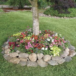 138 best images about outdoor stone landscaping ideas on for Round flower bed ideas