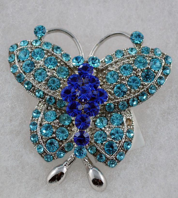 A personal favorite from my Etsy shop https://www.etsy.com/ca/listing/114453517/blue-butterfly-austrian-crystal-brooch