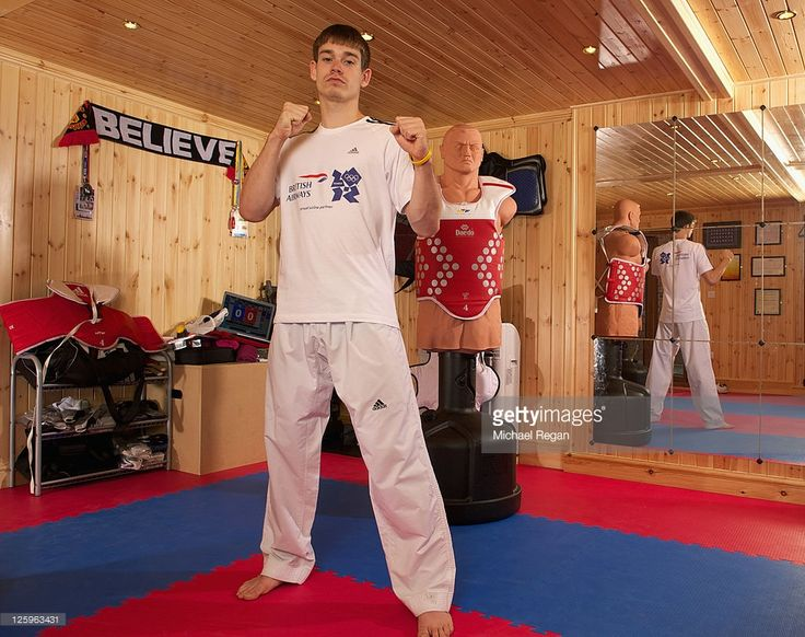 Olympic Taekwondo hopeful Aaron Cook of Great Britain poses for pictures during a British Airways photo feature at the specially constructed gym in the garden of his family home in Gorton on September 21, 2011 in Manchester, England. British Airways is supporting Aaron and his family as he trains and competes around the world on his journey to the London 2012 Olympic and Paralympic Games.