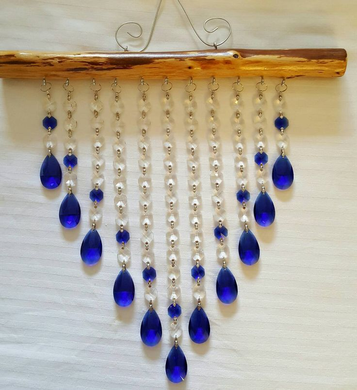 This beautiful suncatcher with sapphire accents was made by me with Love and attention to detail. The photos in this listing shows the 11 Strand and measures approx. 14 inches wide and 19 inches in length including the attached hanger that measures approx. 5 inches from the branch.