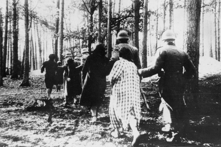 """""""Polish women are led through woods to their executions by German soldiers sometime in 1941."""" (LoC)"""