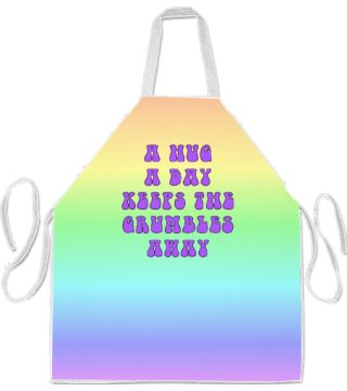 Hug a Day Apron by Terrella.  A Hug a Day Keeps the Grumbles Away printed in purple on a pastel rainbow background.