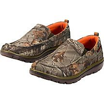 After the hunt, kick off your boots and step into these Men's Montgomery Casual Slip-On Shoes.  Rugged canvas uppers allow your feet to breathe while soft, moisture-wicking lining deals with sweat.  Removable, antimicrobial foot beds feature Realtree® Real Comfort anti-fatigue cushioning, which provides welcome arch support and a pillow-soft comfort.  These casual shoes for men also have lightweight EVA out-soles.
