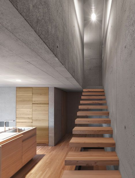 Wooden staircase steps + concrete walls. Haus Rüscher by OLKRÜF   thelayer
