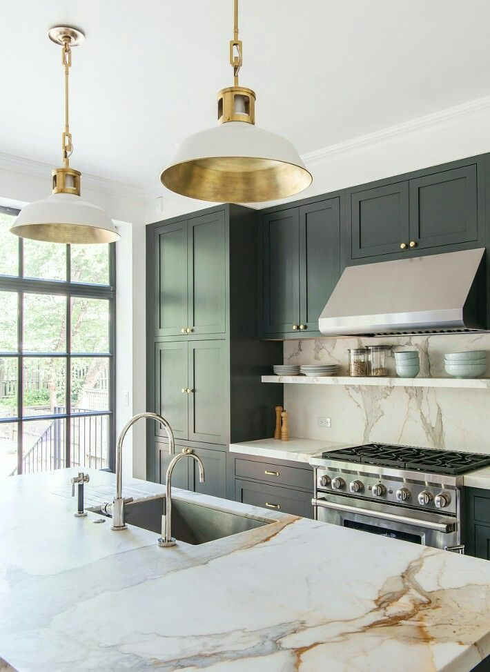 Contemporary kitchen with marble countertops