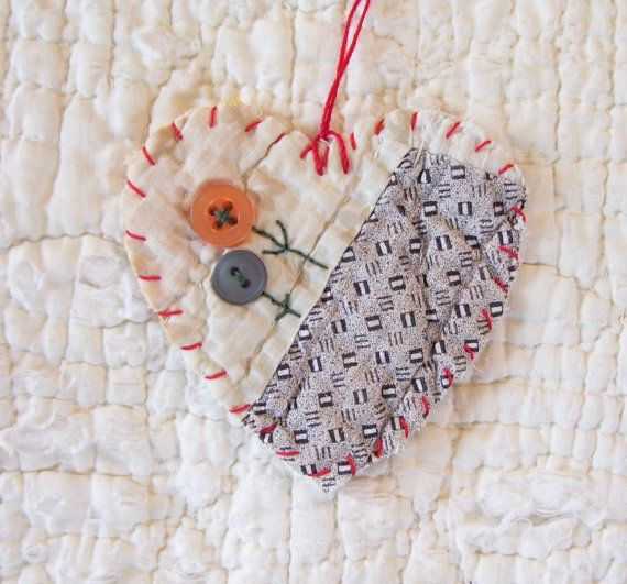 BLOOMIN BUTTONS Heart Snippet Ornament Stitched by wordzoflife. Sweet way to combine buttons and bits of worn out quilts.