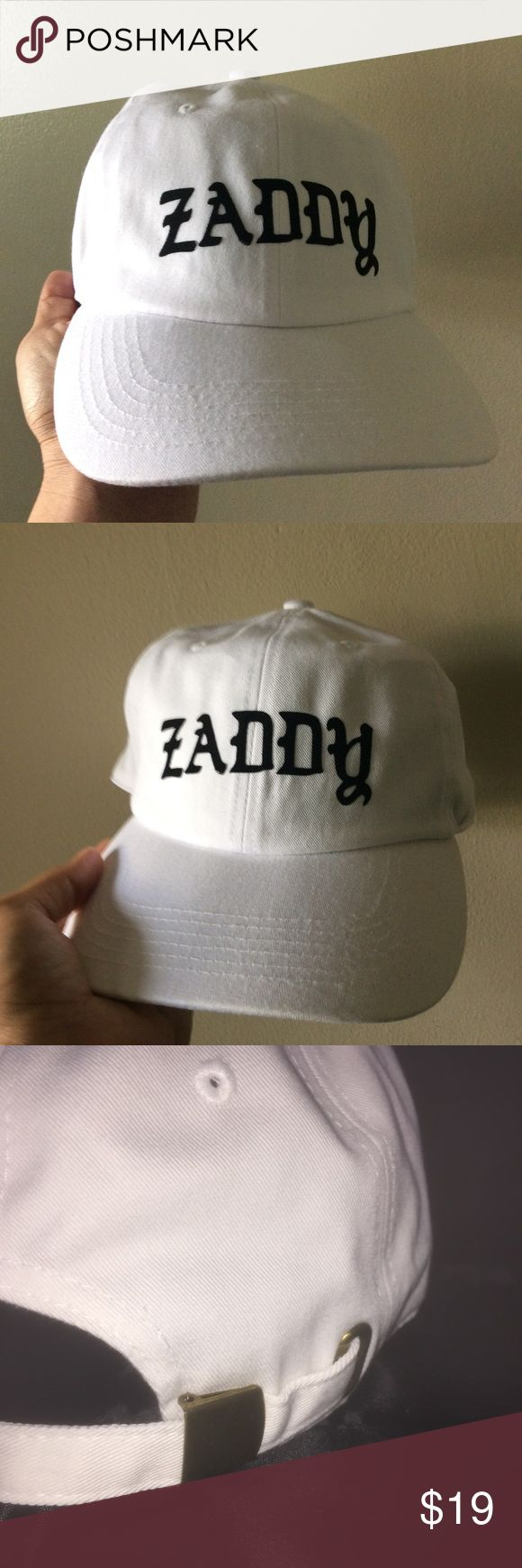 Zaddy Dad Hat NWT This White Strapback Dad Hat is adjustable with tuck pocket NEW___Ignore tags: huf, weed, marijuana, kush, obey, stussy, dope, trill, Blvck, boy london, paris, joggers,  trap style, rave, rare, huf, blvck fashion, trill, pipe, dabber, glass, sad, me, goth, goth girl, woes, the six, 6ix, ovo, blvck, Brooklyn, London, pikachu, 6 God, glitter, naps, mobb, asap, long style, Ovo, snapback, pastel, Brandy, American, urban, anti social club Accessories Hats