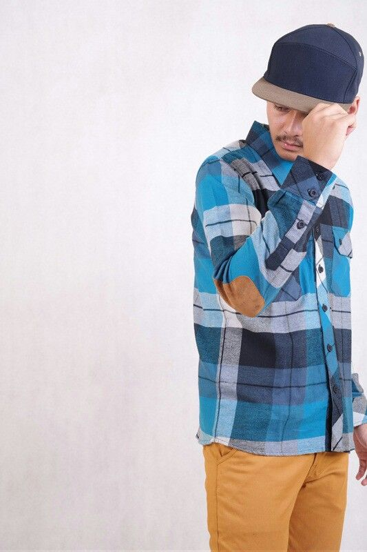 a flanel with an elbow patch