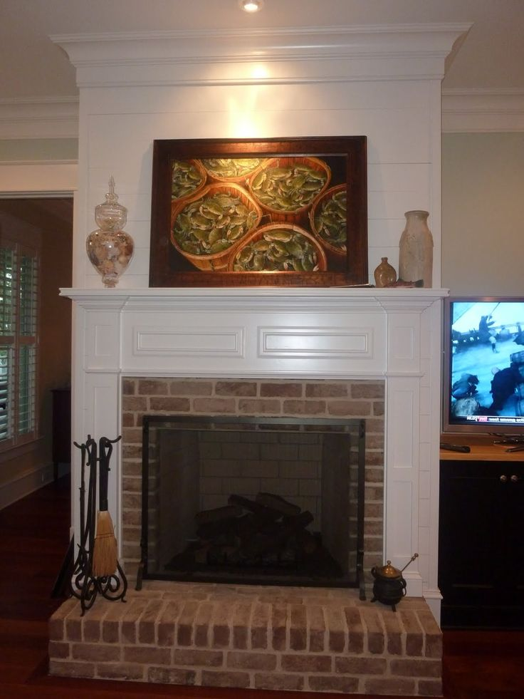 Traditional Brick Fireplace Raised Hearth Paneling Above Mantel Beautiful Stairs