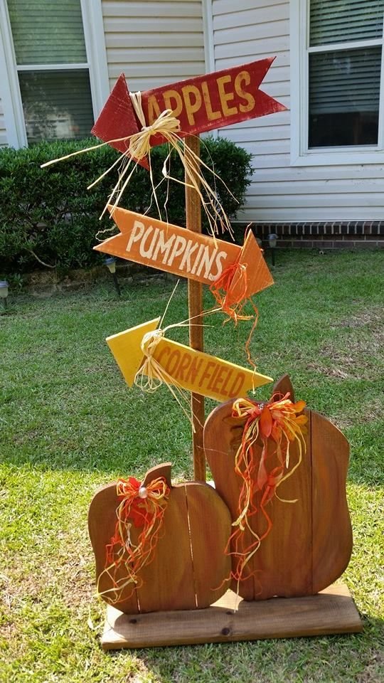 """RECYCLED WOOD PALLETS: How cute is this? The direction yard/porch sign is 48"""" tall. You chose how you want it to stand. We can make a stand or add a pointed end so you can push it into the ground or hay bale. The arrows are 16"""" x 4"""" and let everyone know where to go to get to the apples, pumpkins, and corn. This item is being sold for $22. (The pumpkin duo in front is not included but can be purchased for $26.) Thanks for looking and have a blessed day. Item # 303"""