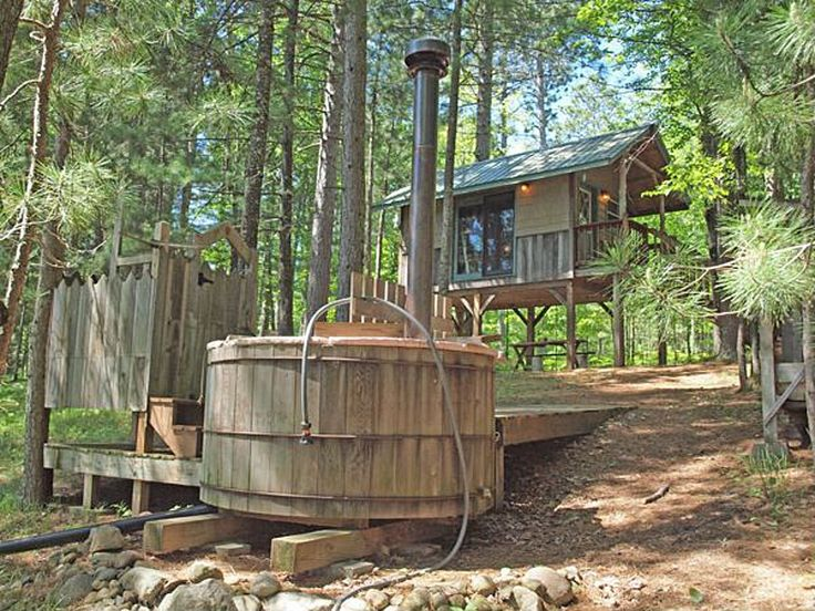 A 128 square feet lake tiny house on stilts with wood-fired hot tub in Gordon, Wisconsin. (pinned by haw-creek.com)