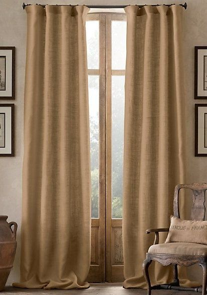 Burlap curtains create a rustic look. Because looking like you live in a barn is a step up from the boxcar you used to live in, olde timey hobo.