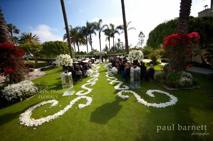 rose petal aisle runner for outdoor wedding ceremonies -   Credit: Paul Barnett via J Grace