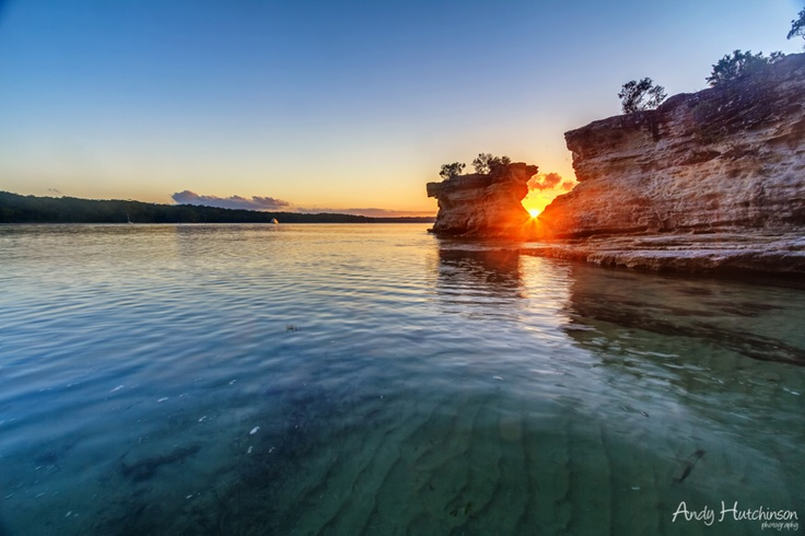 The sun sets over Hole in the Wall Beach, Jervis Bay