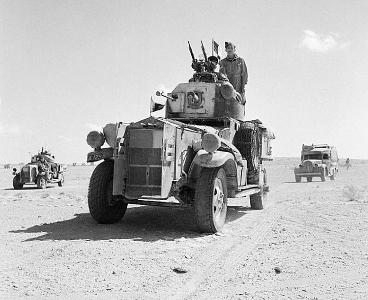 Fordson Armoured Cars and support vehicles of No. 2 Armoured Car Company RAF, leave their base for a patrol in the Western Desert, 1941.