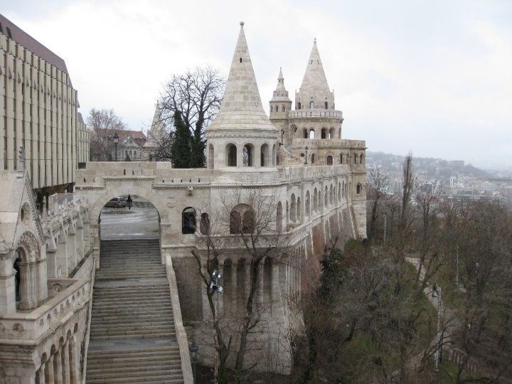 """The Fishermen's Bastion, Budapest, Hungary was designed by Frigyes Schulek and was built in 1905. The """"building"""" is made up of seven towers - each one symbolising the seven Magyar tribes that came to Hungary in 896. During the 18th century, the Guild of Fisherman are also said to have been defending this part of the Castle wall. The Bastion offers great view of the Parliament and of the northern Pest side of the city."""