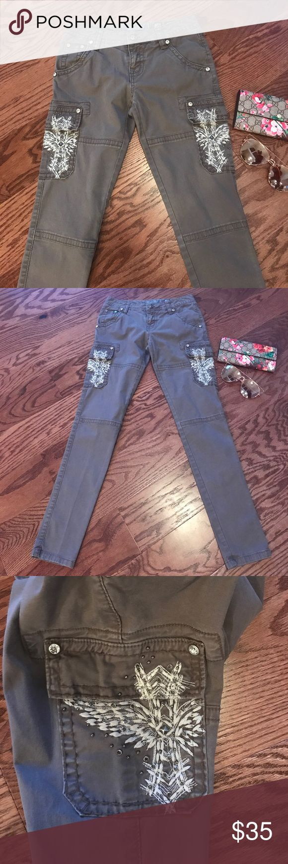 Miss Me skinny stretch cropped cargo pants These are super cute cargo skinny pants. Has cross & rhinestone accent in side pockets . Cotton & spandex blend . Color is khaki . Cropped style  above the ankle but not capris Miss Me Pants Skinny