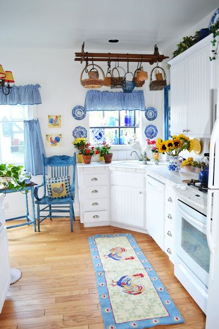 Blue and White Kitchen:  well, if I didn't already have a red and white kitchen, this would be my other choice....so pretty.