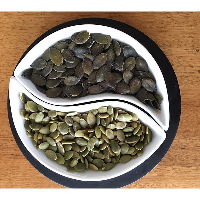 """See the difference between our Styrian Organic Pumpkin Seeds (top) and others (bottom). Our fresh and crispy pumpkin seeds are quite different. Styrian Pumpkin seeds do not have a seed shell – they have a smooth, dark green skin. Other varieties have a hard, fibrous husk or outer shell, which must be removed to reveal the kernel or inner seed. Because of this, Styrian Pumpkin seeds are often confused with """"pepitas"""", which are simply the kernel of a common pumpkin seed."""
