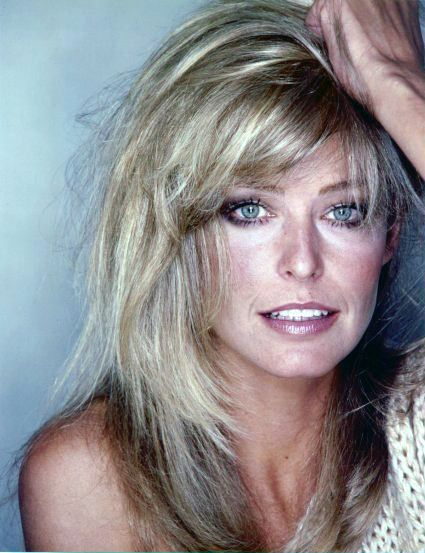 Farrah Fawcett....I'm still hoping that one day I'll wake up  have hair like her.....not likely to happen, but a woman can dream!