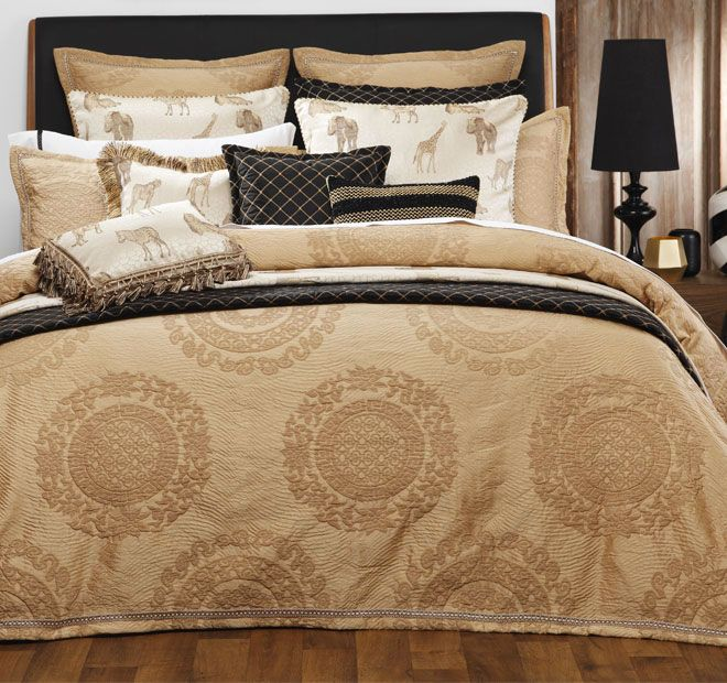 Zanzibar Gold DAVINCI   Satisfy your spirit of adventure with the exotic styling of Zanzibar.  Features: Polyester Woven yarn dyed jacquard Large scale medallion motifs in quilting effect Crinkle textured ground Decorative braid border inset to tailored flange Plain dye cotton and polyester gold reverse - #quiltcovers