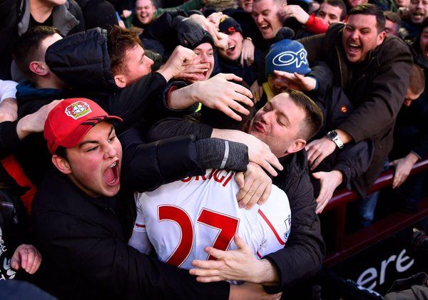 Divock Origi talks bout being slobbered with kisses by Liverpool fans at Villa Park (Video)