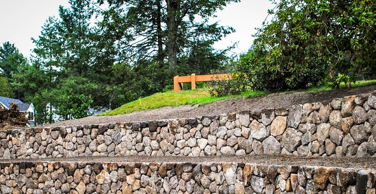 Terraced retaining walls garden landscaping pinterest - Natural stone wall solutions ...
