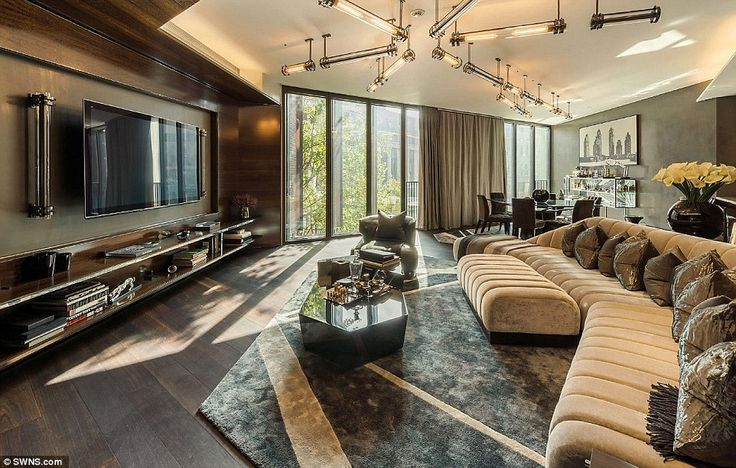 It may have only one-bedroom, but the £10million apartment for sale at One Hyde Park boasts this huge living room with a large flat-screen TV