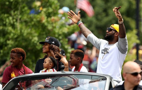 LeBron James #23 of the Cleveland Cavaliers and his family look on during the Cleveland Cavaliers 2016 NBA Championship victory parade and rally on June 22, 2016 in Cleveland, Ohio. - Cleveland Cavaliers Victory Parade And Rally