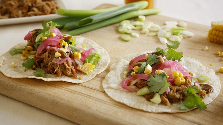 Slow-cooked pulled pork, served on tortillas.