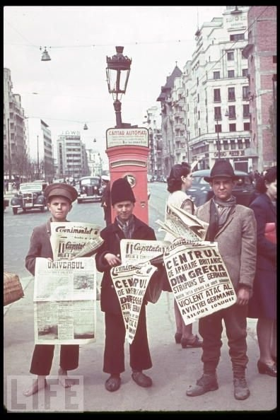 Bucuresti - Romanian newspaper vendors in Bucharest hold up papers announcing the Nazi invasion of Greece and the Blitz in London , 1940