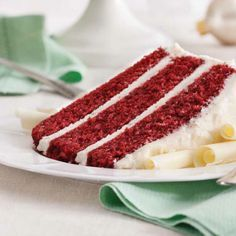 Red Velvet Cake Recipe Desserts with Swans Down Cake Flour, sugar, unsweetened cocoa powder, baking soda, salt, vegetable oil, buttermilk, large eggs, red food coloring, vanilla extract, vinegar, butter, cream cheese, vanilla extract, confectioners sugar, white chocolate curls
